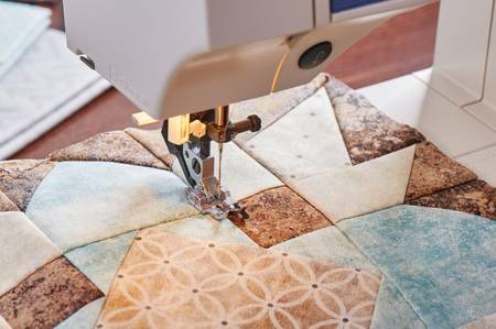 Sowing Machine Working On Quilt - Christmas Bed Quilts