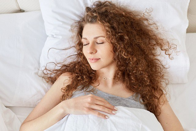 Woman with Frizzy Hair - Best Pillowcase for Hair